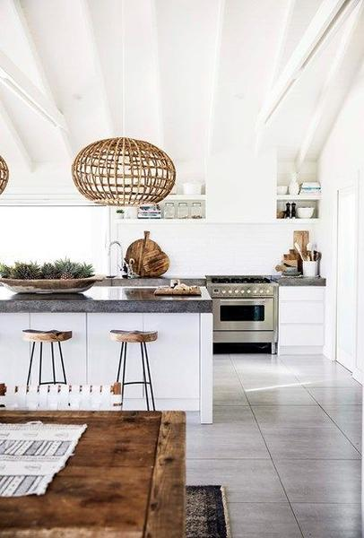 White kitchen with wood accents and basket pendant