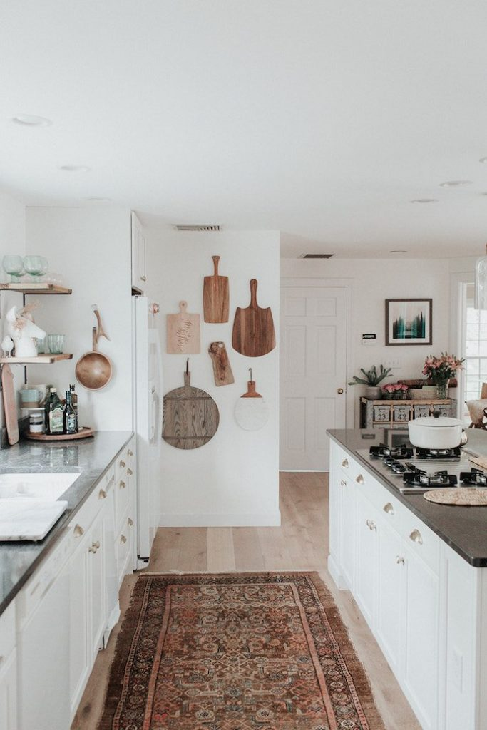 Wooden boards and rug in kitchen