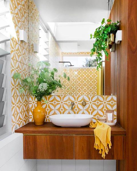 Yellow tiles and wood bathroom