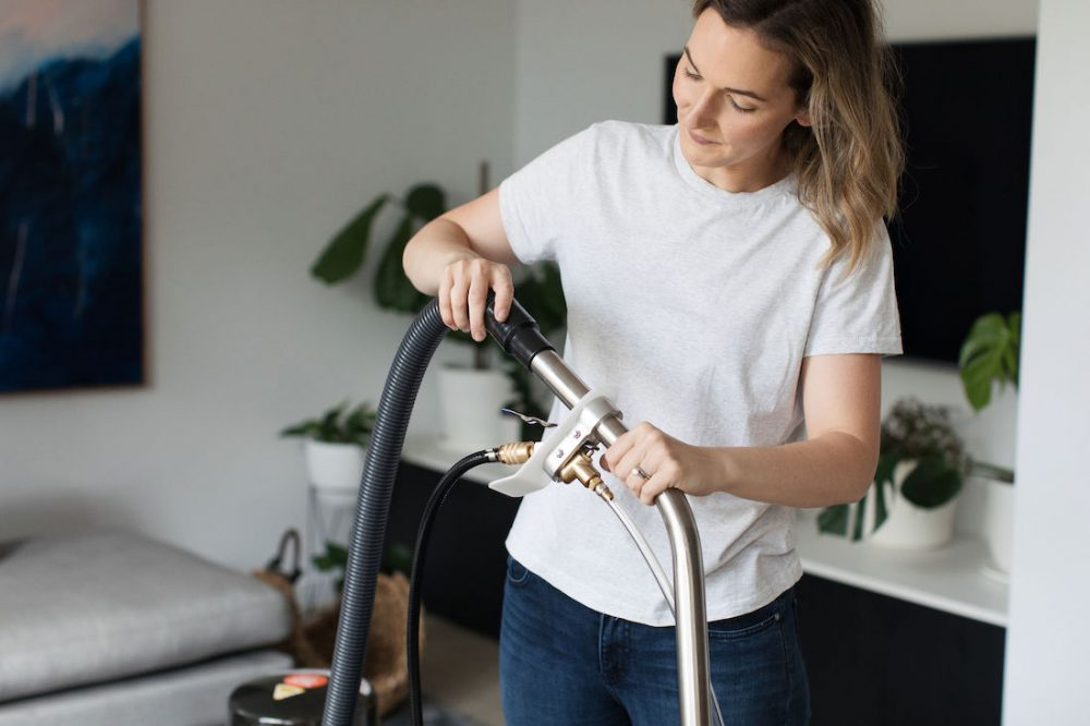 Attaching hose to cleaner deep clean your home