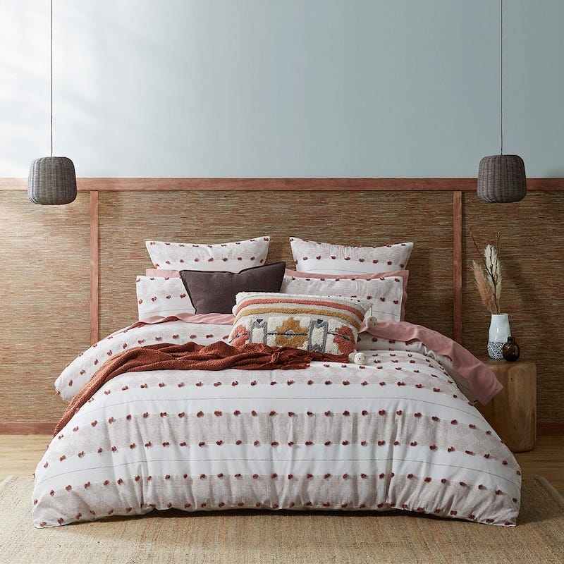 Tufted rust quilt cover