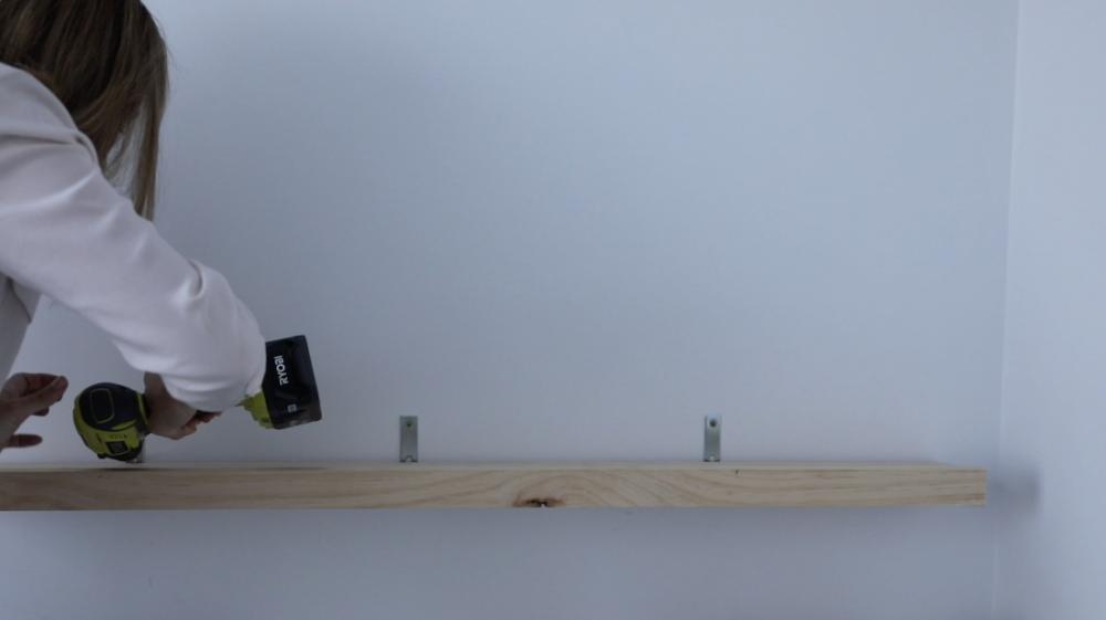 Screw shelf to wall