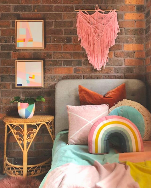 The Colour Tribe_80s home_bedroom with rainbow cushion