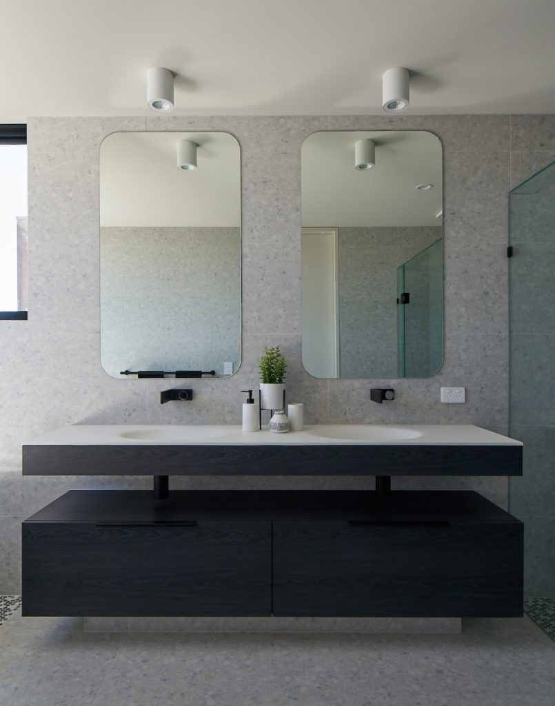Modern bathroom with rectangular curved mirrors