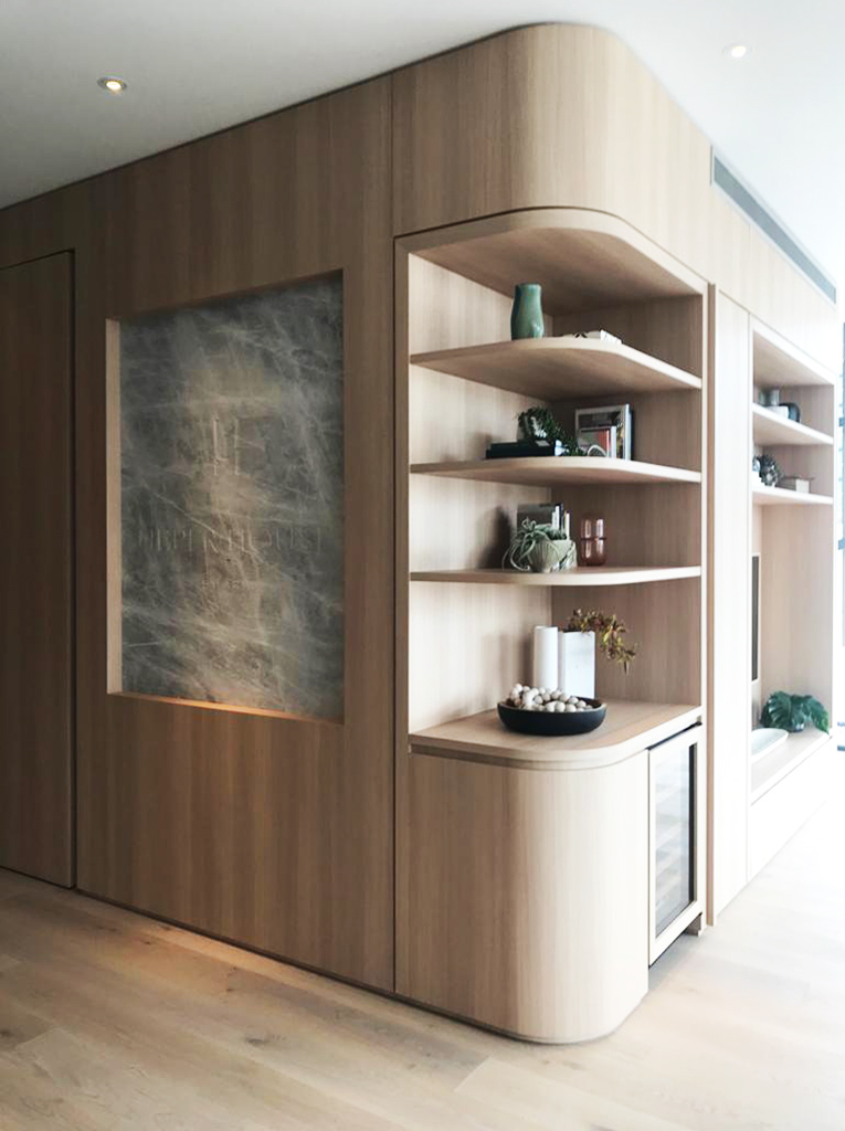 Curved detail in custom joinery wall