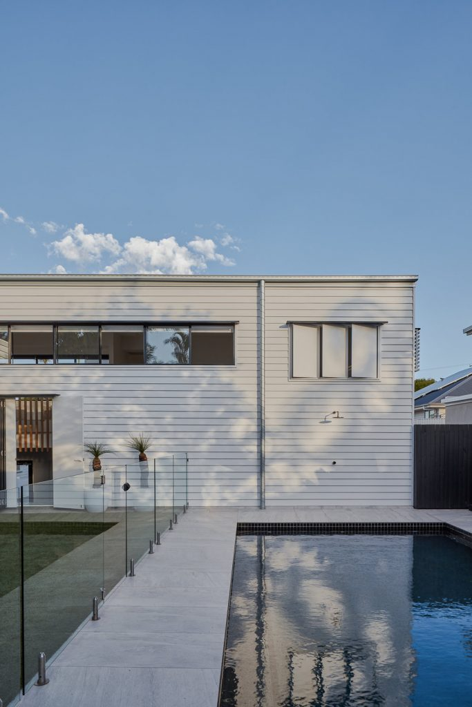 Back of modern home with pool