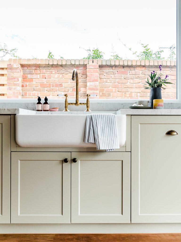 Soft green kitchen cabinets
