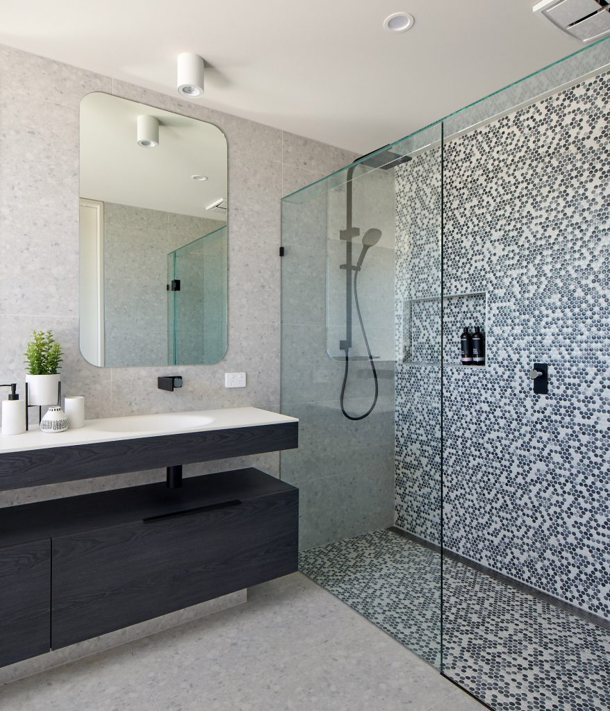 Frameless showerscreen with honeycomb tile