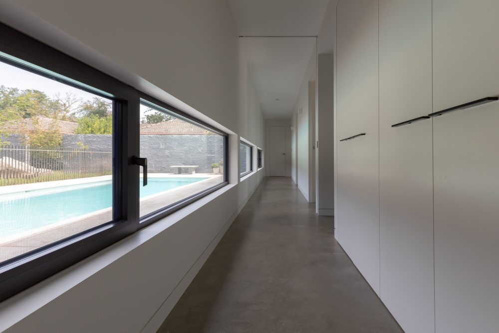 Low windows in hallway of Concrete House
