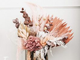 Dried floral arrangment on bedside table