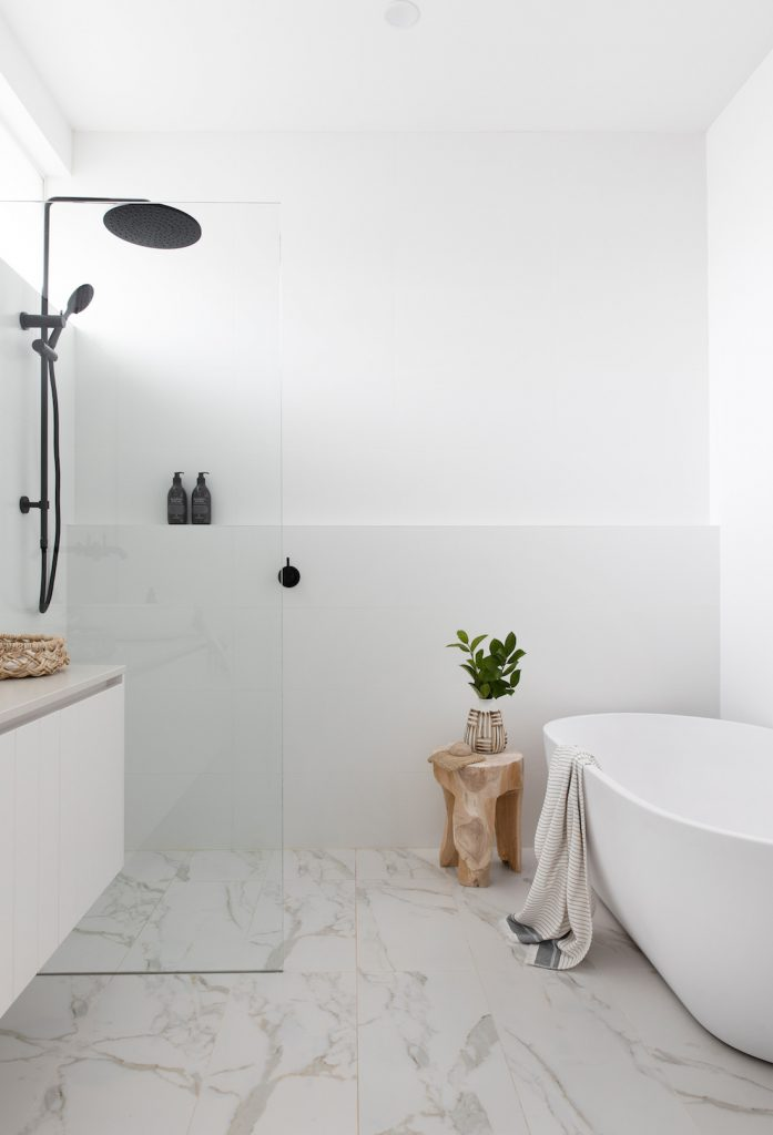 White and grey bathroom with freestanding bath