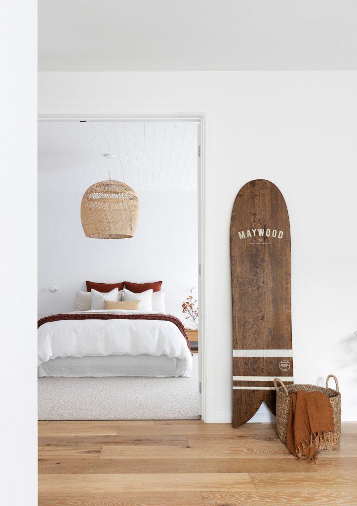 Bedroom with wooden surfboard