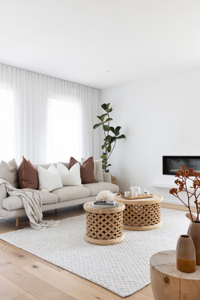 White living room with rust accents