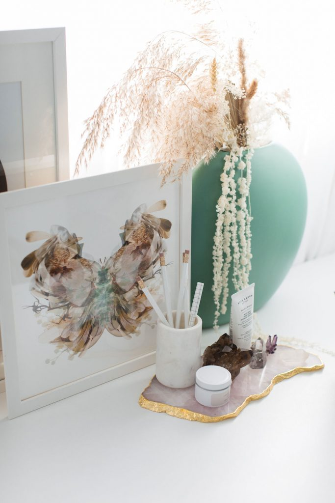 Artwork and crystals in home office