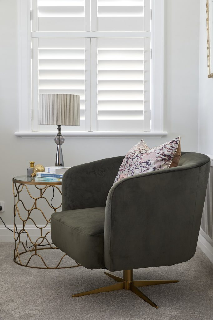 Tub chair and gold side table in guest bedroom The Block 2020 Daniel and Jade