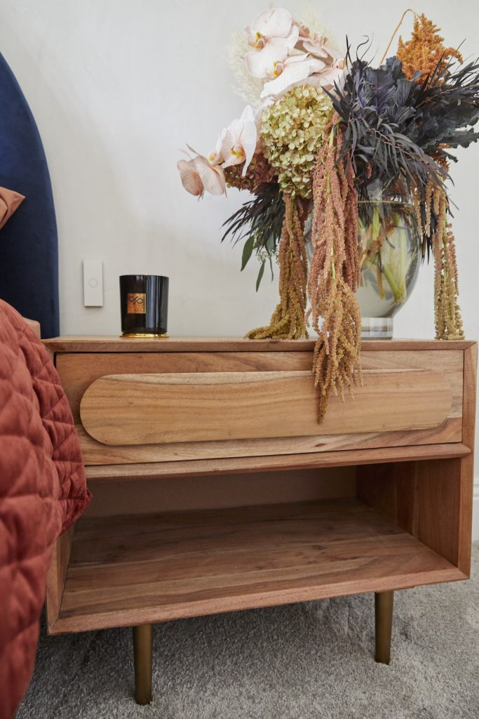 Bedside table styling in guest bedroom by Luke and Jasmin
