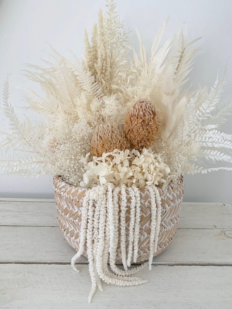 Dried floral arrangement by Wicker and whitewash