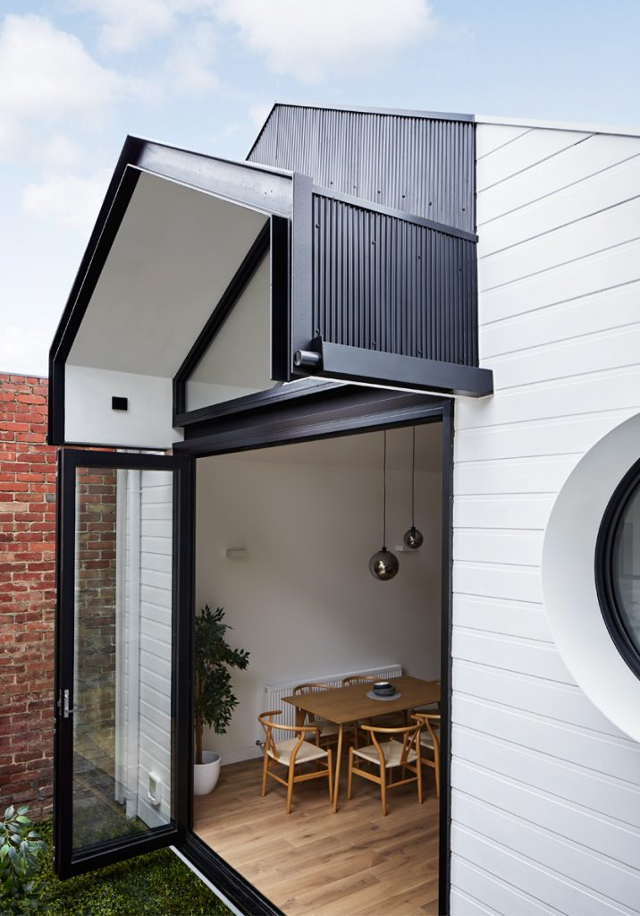 Dot's House_Atlas Architects_back door cool cladding around modest extension