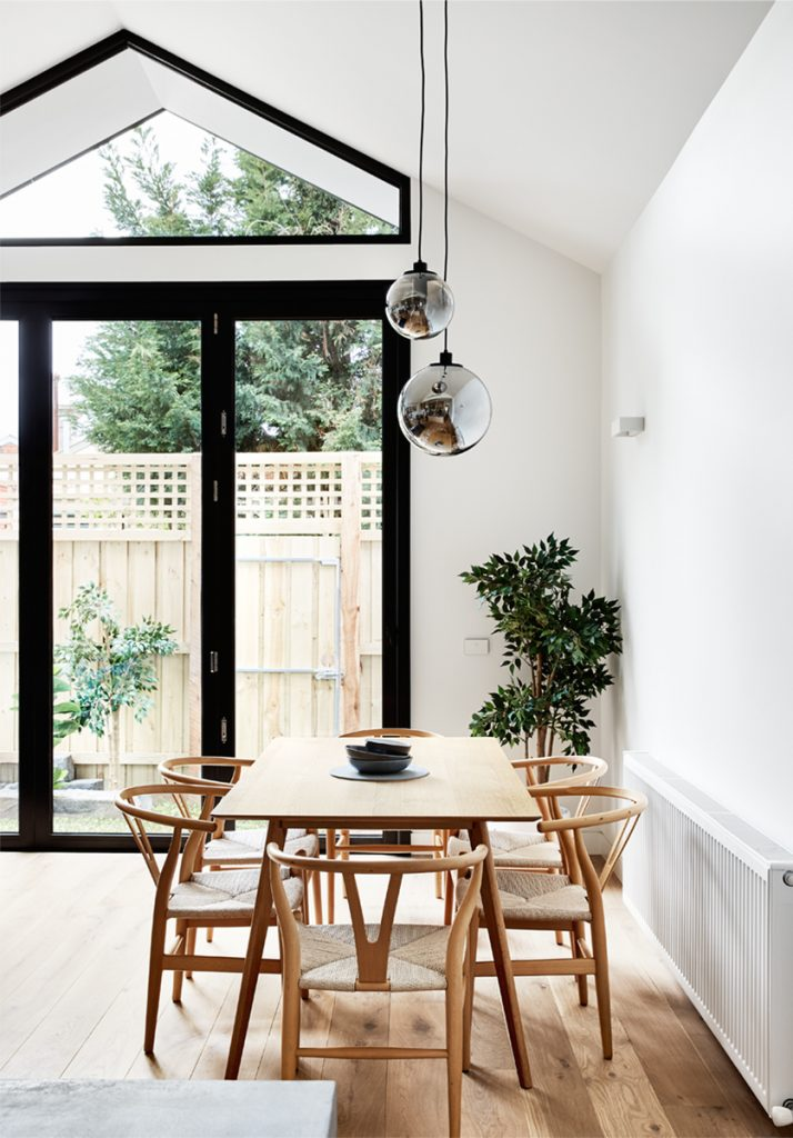 Dot's House_Atlas Architects_dining room_ cathedral ceiling in modest extension