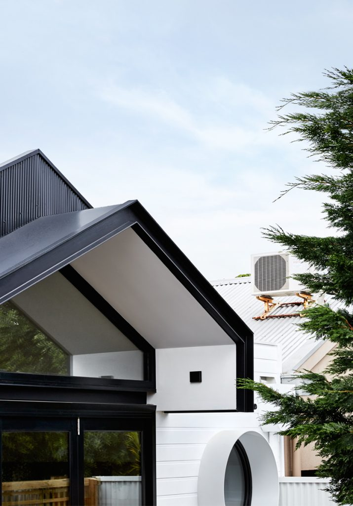 Dot's House_Atlas Architects_roof line and circular window