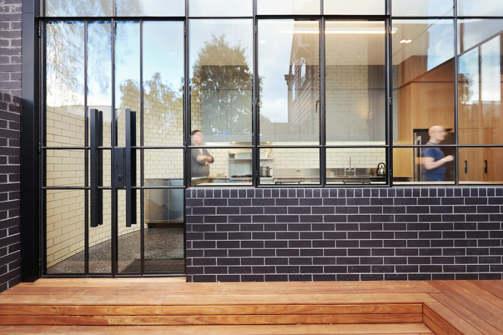 Turn House_Rebecca Naughtin Architect_glass and brick wall