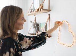 Placing DIY heart wall light in room