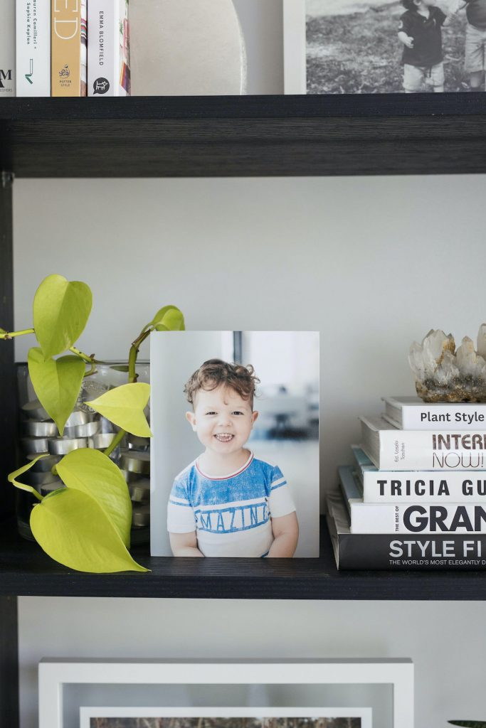Photo block ways to incorporate family photos in shelf styling