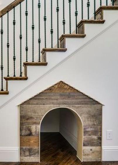 Pet kennel under stairs