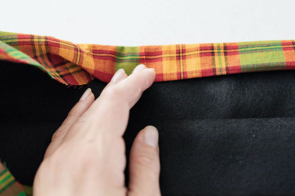 Roll and sew neat edge along top