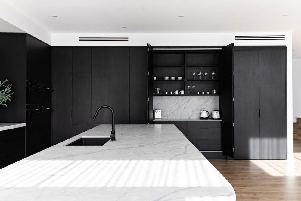 Breakfast bar hidden behind cabinetry
