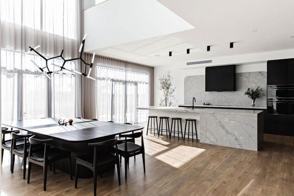 Open plan black kitchen dining space