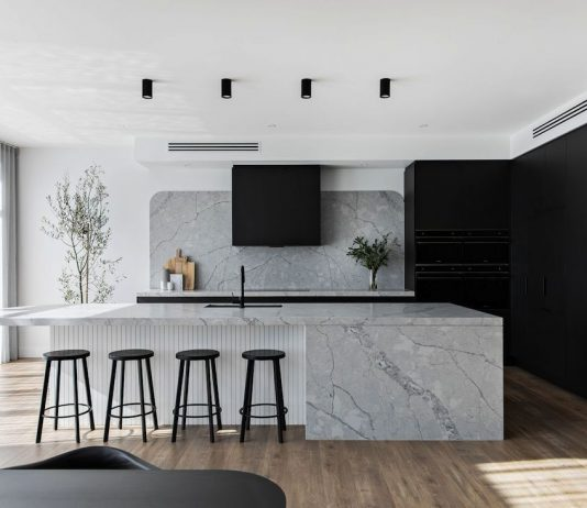 Black kitchen with integrated appliances