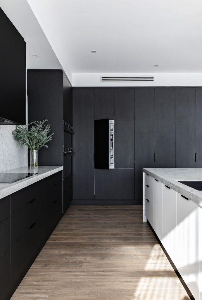 Black kitchen with integrated fridge