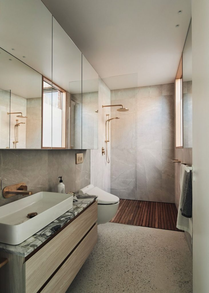 Neutral bathroom with marble benches