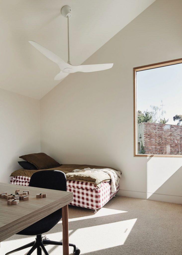 minimalist bedroom with ceiling fan