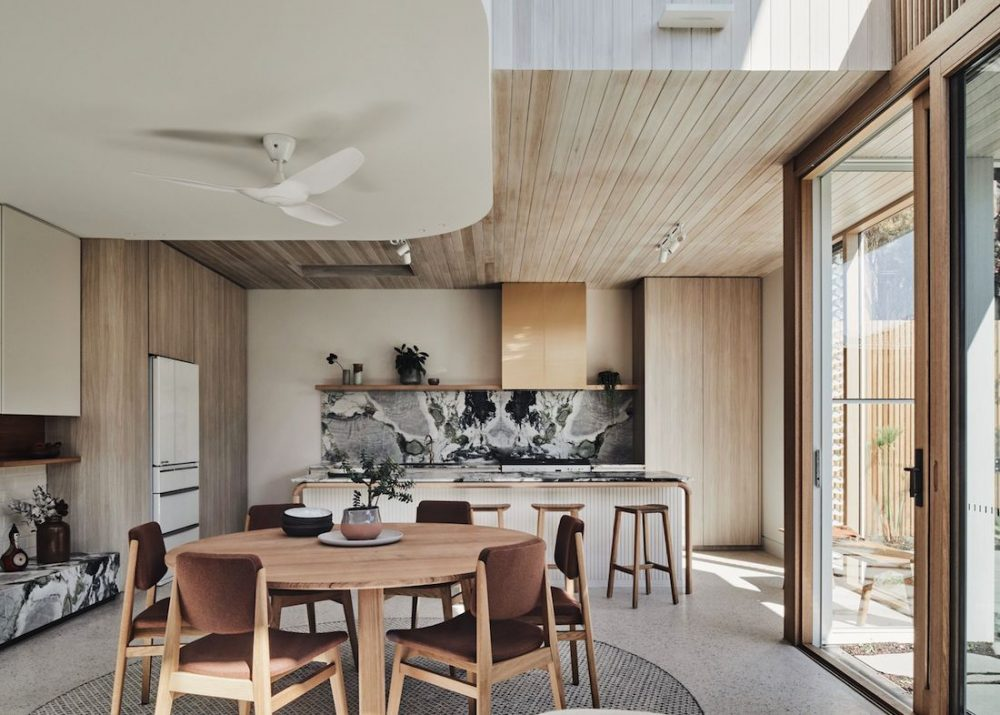 Open plan living dining room with curved ceiling detail