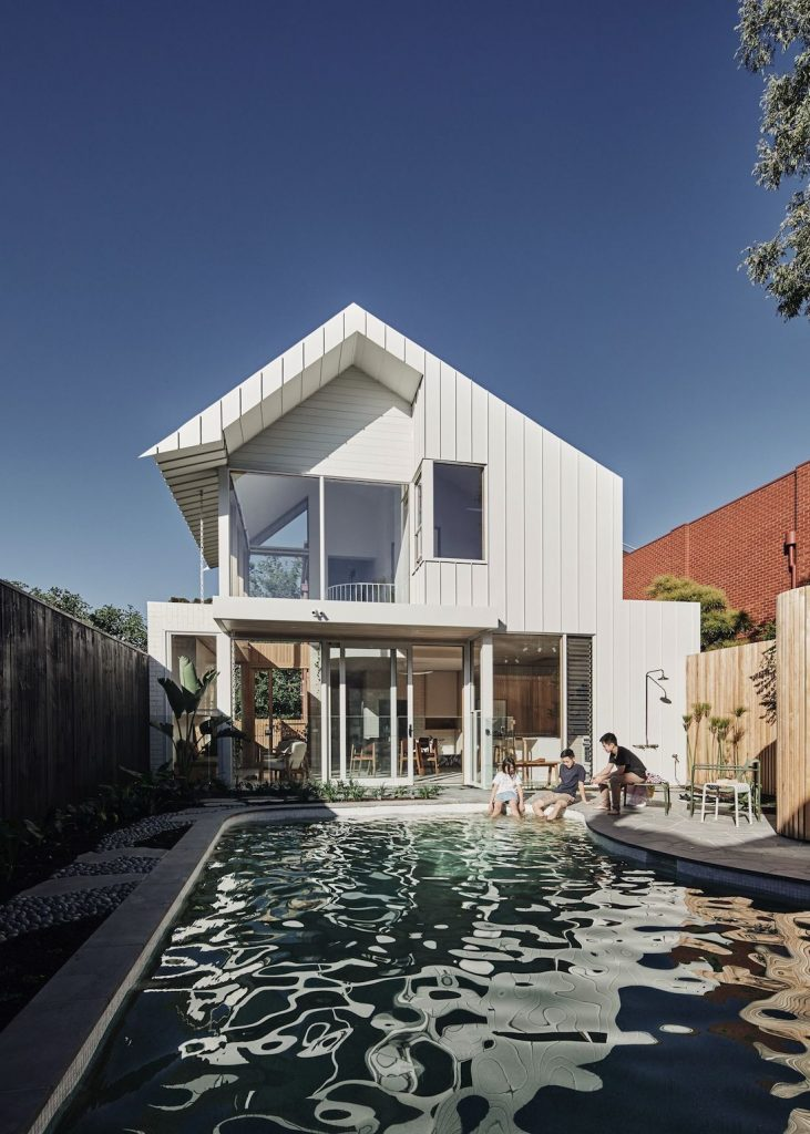 Exterior of lantern home with pool