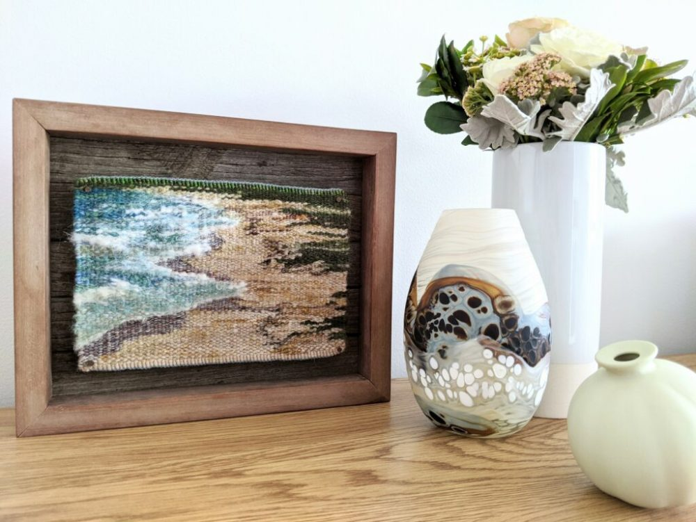 Ocean tapestry art piece in timber frame