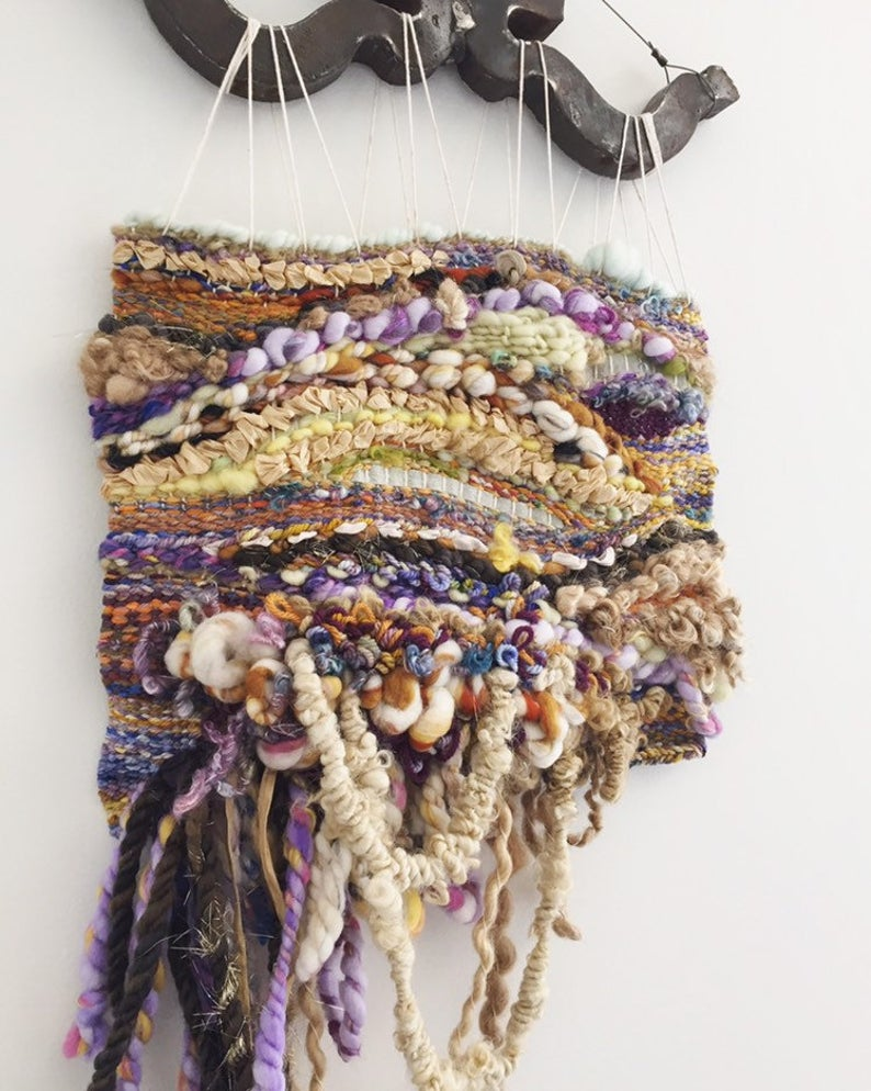 Tapestry woven art
