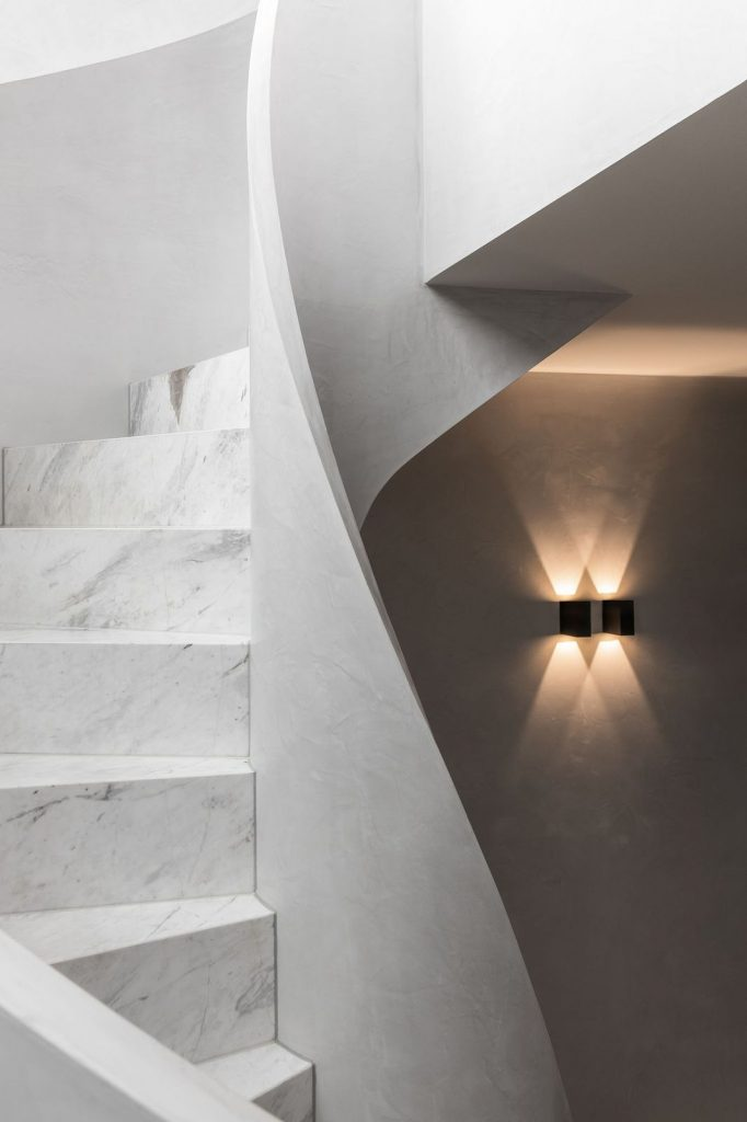 Marble curved staircase in Penthouse