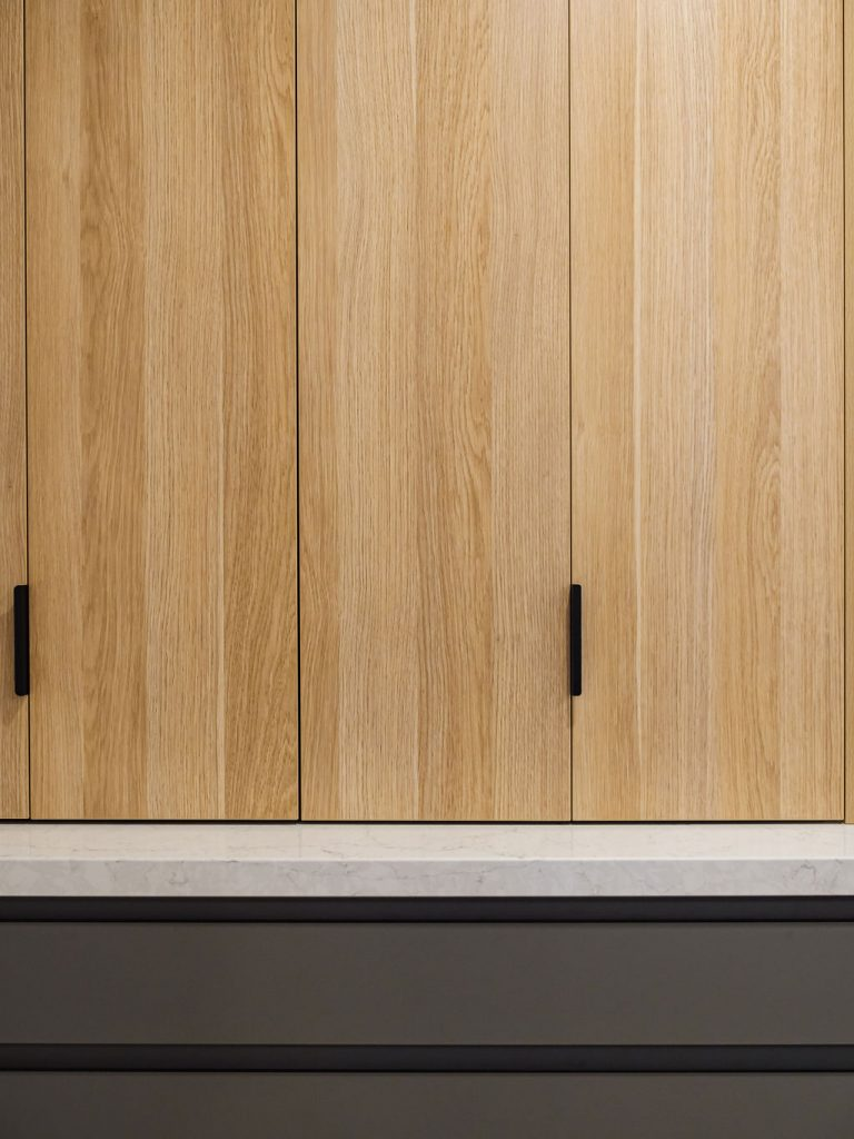 Timber cabinets with black handles