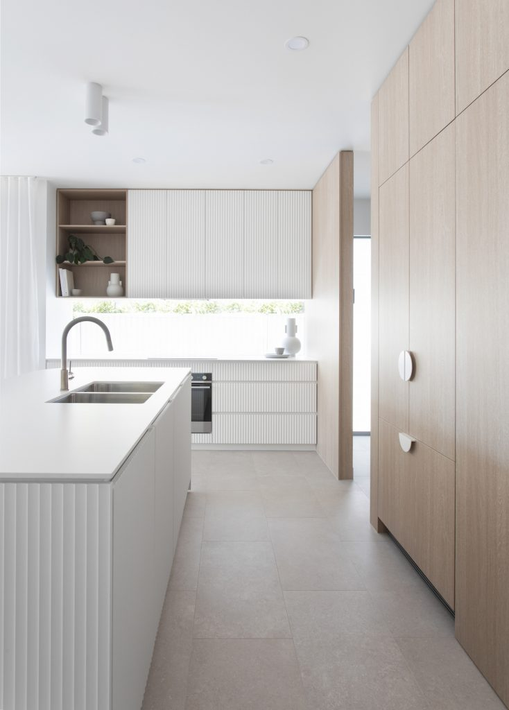 Length of modern timber and white kitchen