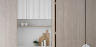 Timber doors in scalloped edged draws and penny tile pantry