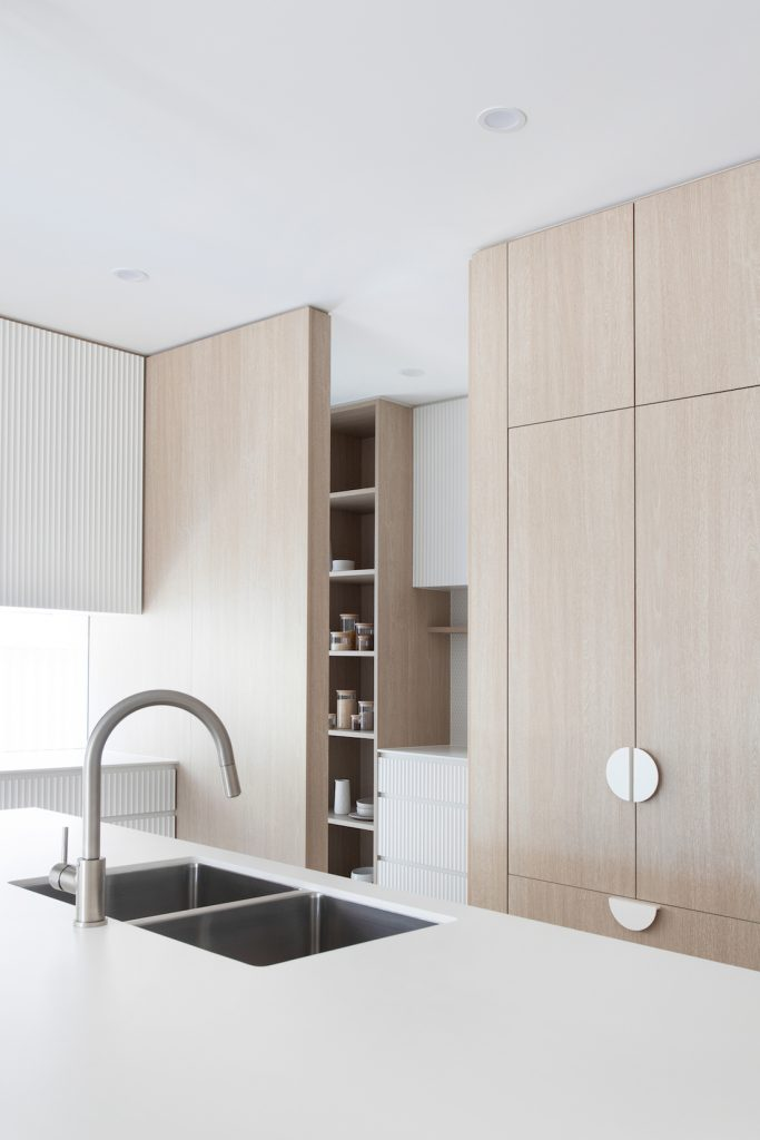 Gooseneck tap in white and timber kitchen