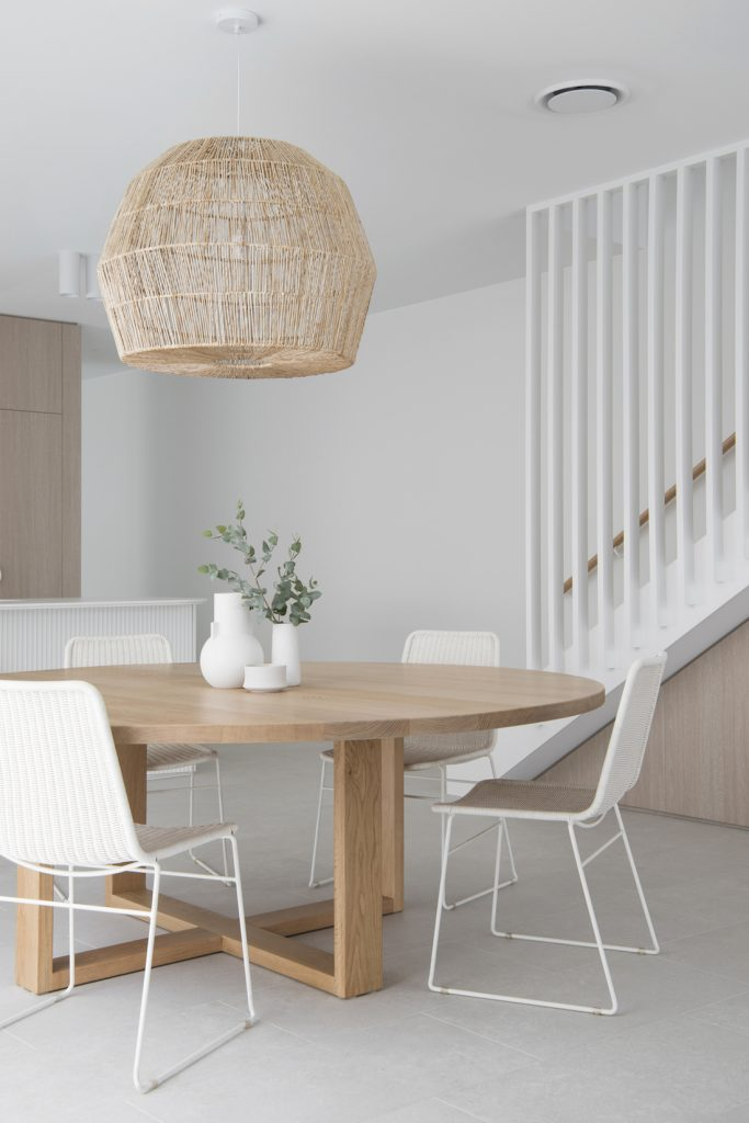 Round dining table with basket pendant