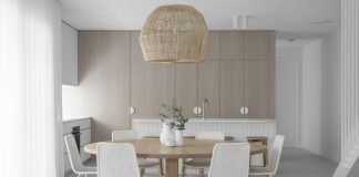 Basket pendant light over round dining table