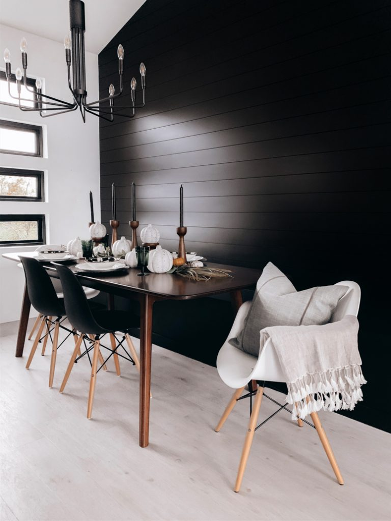 Black feature wall in Scandi dining room