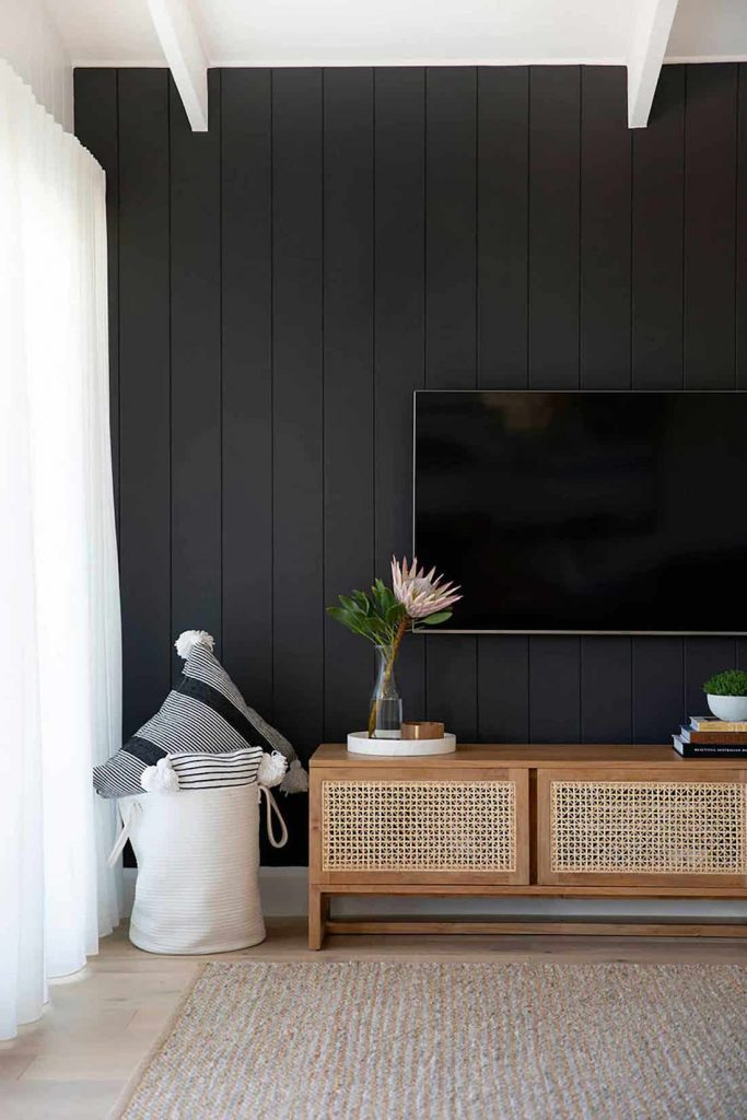 Black wall with panels in living room