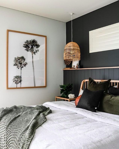 Black feature wall in bedroom with built-in shelf