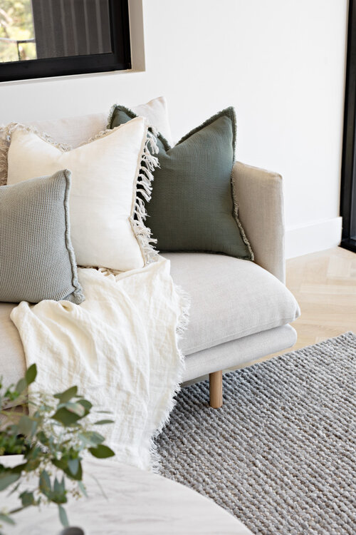 Couch with cushions and throw
